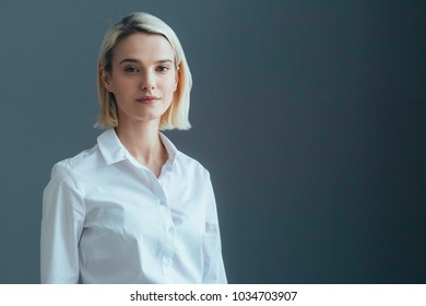 Business woman portrait over gray wall