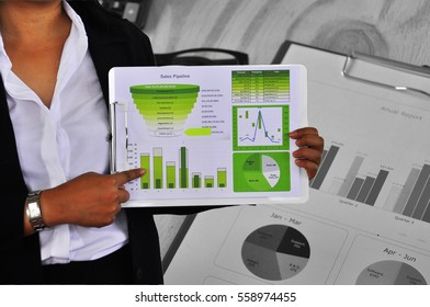 Business woman present investment consultant analyzing company annual financial report balance sheet statement working with documents graphs. Concept picture of economy, market, office,money and tax.