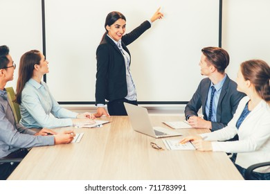 Business Woman Presenting Project to Coworkers
