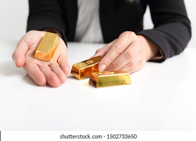 A Business woman presents Gold bullion bar
