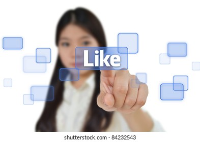 Business woman pressing like button on screen