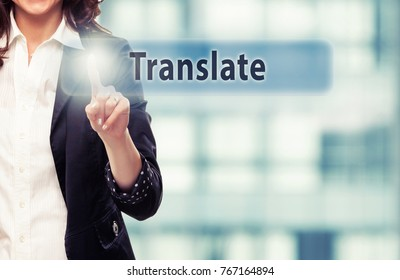 Business woman pressing Translate button at her office.