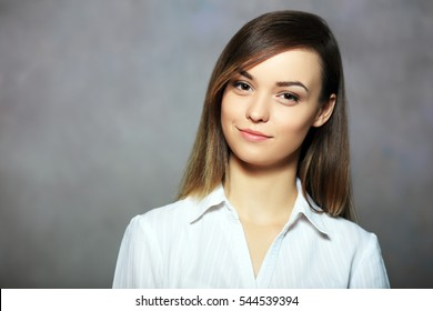 business woman professional portrait. Young female businesswoman close up portrait isolated on art background. Mixed race Asian Caucasian female model in her twenties.
