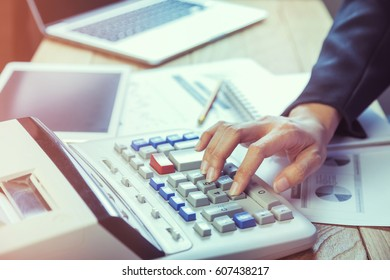 Business woman putting her hand on calculator, business and investment concept
