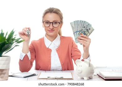 Business woman or real estate agent showing keys and bunch of money banknotes