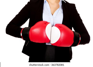 Business woman in red boxing gloves
