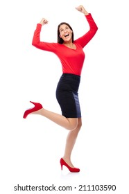 Business Woman in red celebrating doing the Winner dance