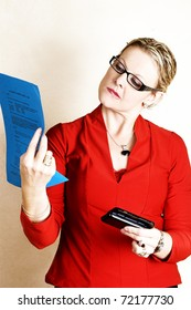 Business woman in red holding a blue sheet of paper