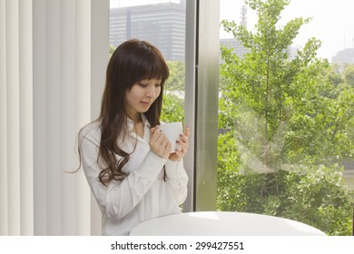 Business woman relaxed with a cup of coffee