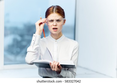 Business woman with a report, a woman from the boss, a report on the work of