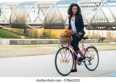 Business woman riding a vintage bicycle in the city