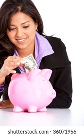 Business woman saving money in a piggy bank isolated