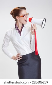 business woman is screaming to her associate with megafon  isolated white background