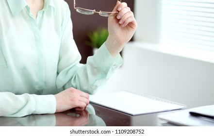 Business woman or secretary  sitting at the desk in the office. Green toned image