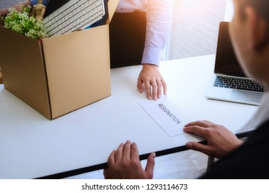 Business woman sending resignation letter to boss for dismiss contract employer. Concept resign depress and resignation.