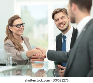 Business woman shaking hand to  her  partner
