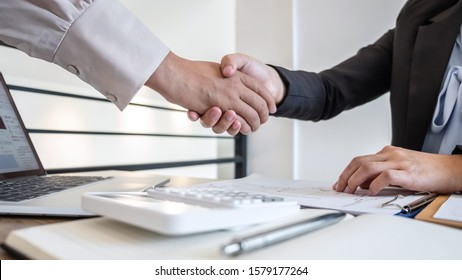 Business woman shaking hands after conversation, Finishing up a collaboration discussing of partner cooperation in investment marketing project and successful contract agreement to become teamwork.