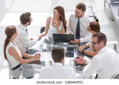 business woman shaking hands with a business partner on a business meeting