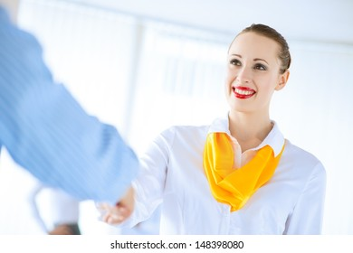 Business woman shaking hands and smiling colleague