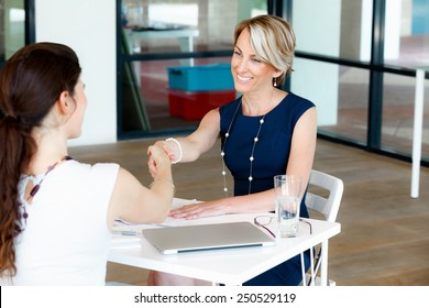 Business woman shaking hands with someone