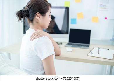 Business woman with Shoulder ache