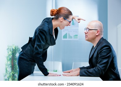 business woman shouting against a business man or a male office worker