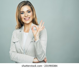 Business woman show ok symbol. Toothy smiling business woman portrait.