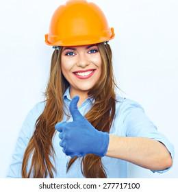Business woman show thumb up. Woman builder portrait. Protect helmet.