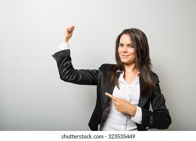 Business woman showing biceps