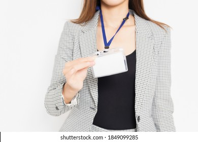 A business woman showing a name folder shot in the studio