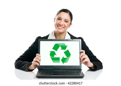 Business woman showing a recycling symbol on her laptop, symbol of environmental conservation. Isolated on white background