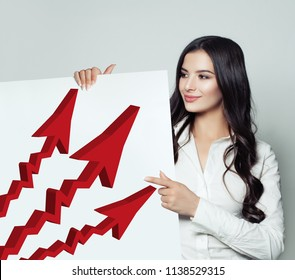 Business Woman Showing Singboard Banner with Red Rising Arrow , Representing Business Growth. Business Success and Shares Up Concept
