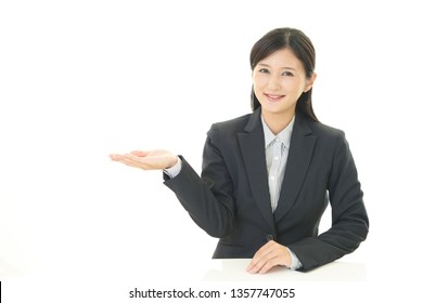 Business woman showing something on the palm of her hand.