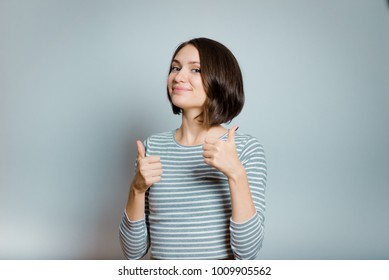 business woman showing thumbs up, like it, isolated on background, studio photo
