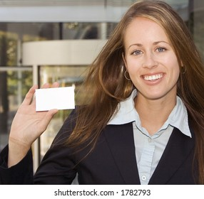 A business woman is showing you her black business card.