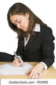 business woman signing papers over a white background
