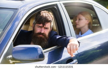 Business woman sit on backseat while bearded driver sit in front. Car with open windows and passenger. Business lady passenger has private driver. Personal assistant and driver. Business life concept.