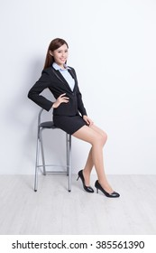 business woman sit on chair with white wall background, great for your design or text, asian beauty
