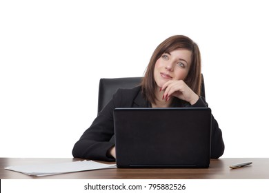 business woman siting at her desk at work daydreaming at work