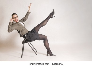 business woman is siting on the chair