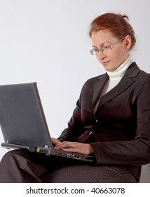 business woman sitting with computer on her knees