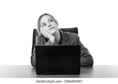 business woman sitting a a desk with a laptop computer in front of her