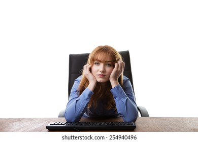 business woman sitting at her desk not looking very happy