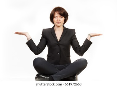 business woman sitting in lotus position. Concept of Balance
