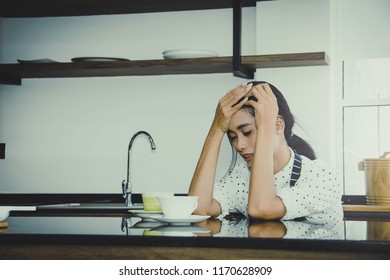 Business woman sitting sad and troubled business person due to financial and economic downturn.
