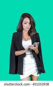 Business woman smartphone on green screen