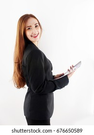 Business woman smiling in black suit holding folders documents about project work isolated on white background.