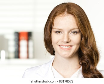 business woman smiling, in an office