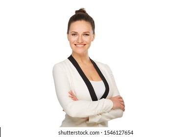 Business woman smiling in a white jacket with her hair collected stands with folded arms, portrait to the waist