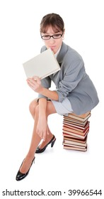 business woman  in spectacles and a pile of books